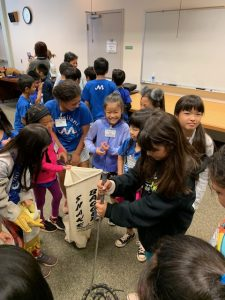 Students learn how to catch a snake...a fake one.