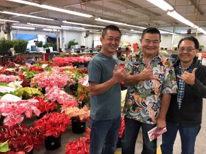 Deputy Glenn Muranaka (center) visits Green Point Nurseries with Thong Teng Neo (left) and Eric Tanouye (right)